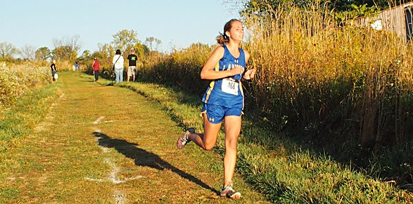 xc Lansing senior Mikaela Garcia cruises to the win in her last home meet